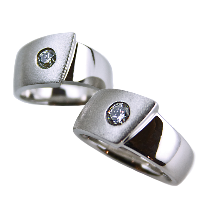 """Harmony III"" ladies ring - Round Brilliant cut Diamond, .33cts, set in 14k white gold. ""Harmony III"" men's ring - Round Brilliant cut Diamond, .52cts, set in 14k white gold."