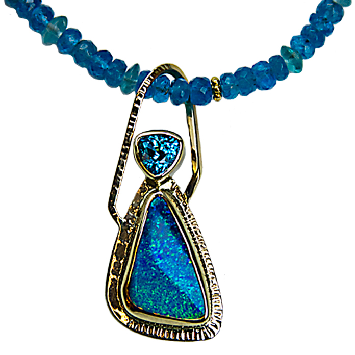 """""""Exotic"""" slide pendant — Australian Boulder Opal, 28x15x22mm and Trillion cut Blue Zircon, 1.39cts. Set in 22k and 14k yellow gold."""