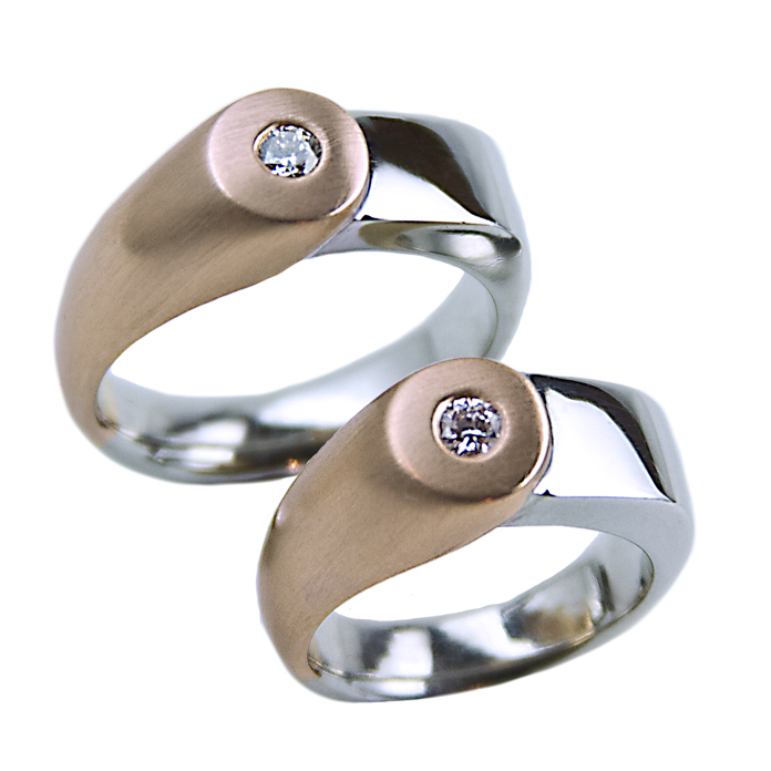 """Harmony Rose"" men's ring - Round cut Diamond, 15cts, set in 18k rose gold and 14k white gold. ""Harmony Rose"" ladies ring - Round cut Diamond, .14cts, set in 18k rose gold and 14k white gold."
