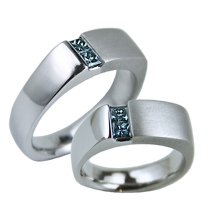 """Offset Channel"" men's & women's rings — Two melee round cut diamonds set in white gold."