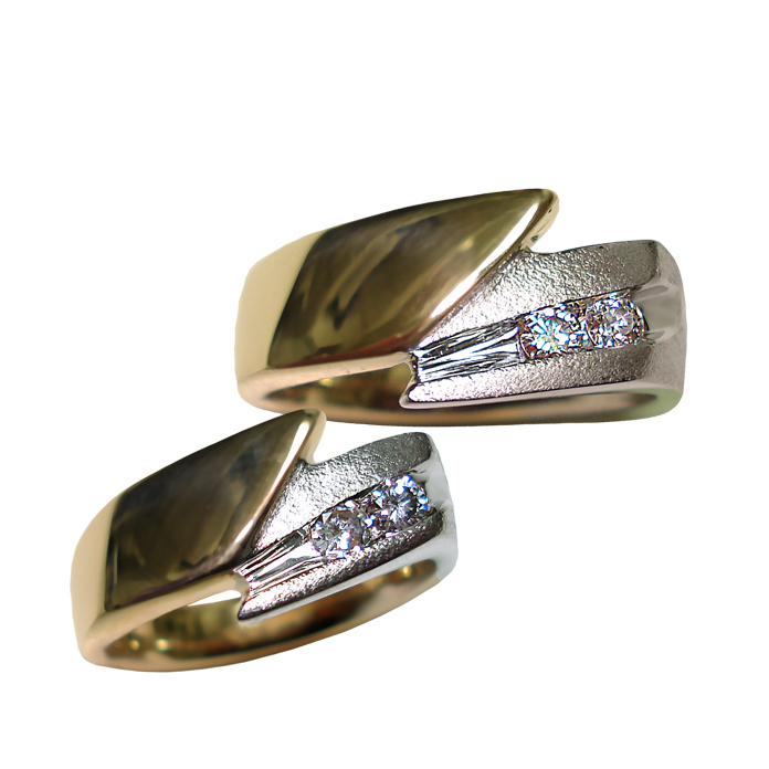 """Harmony Comet"" men's ring — Two round diamonds, VS, G-H color, with a total weight of .20cts set in 14k yellow gold and rhodium plated white gold. Ladies ring — Two round diamonds, SI, G color, with a total weight of .28cts set in 14k yellow gold and rhodium plated white gold"