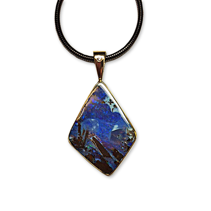 """Mountain Night"" - Dream-like Australian Boulder landscape opal pendant hand-fabricated in 14 and 22k yellow gold. One diamond weighing .03 carat."