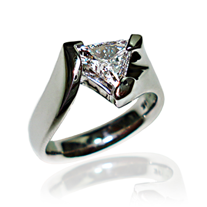 """""""Trillion Perfection"""" Ladies Ring – One of our most difficult settings takes center stage again with a .78 carat, 8.6-millimeter, diamond. The diamond has a VS2 clarity and E color and is set in 14 karat white gold. A show stopper."""