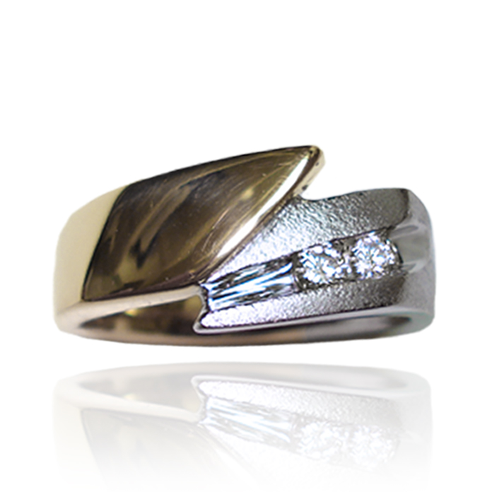 """""""Harmony Comet"""" Men's Ring – Like comets in the sky, two round brilliant channel set diamonds, shoot across the 14 karat yellow and white gold setting. Our signature """"Harmony Comet"""" design can be varied using your choice of gold and diamonds. The diamonds total .20 carats, VS-2 clarity and G-H color."""