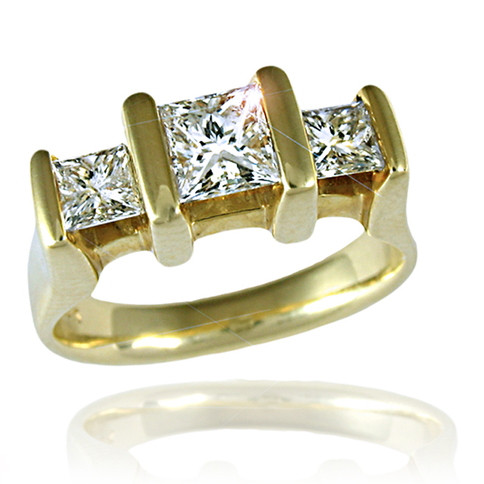 """Triple Suspension"" ladies ring – Three Princess cut Diamonds (one .76cts, two with a combined weight of .59cts), set in 18k yellow gold."