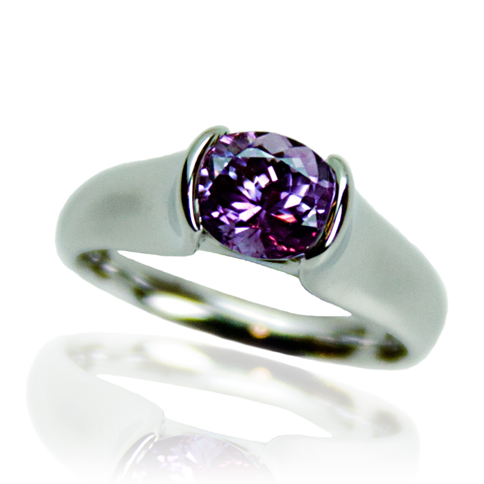 """Lavendar Pink Suspension"" ladies ring — Oval cut desaturated Pink Sapphire, 1.94cts, set in 14k white gold."