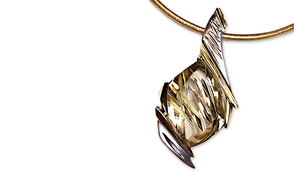 """""""Rain in the Wind"""" — Creativity ran wild in the creation of this Rutilated Quartz pendant by master goldsmith Damian Koorey. The stone was cut by German master Sonja Kriess, and set in 14k white and 18k yellow gold. Each piece of the pendant was individually casted and then welded together."""