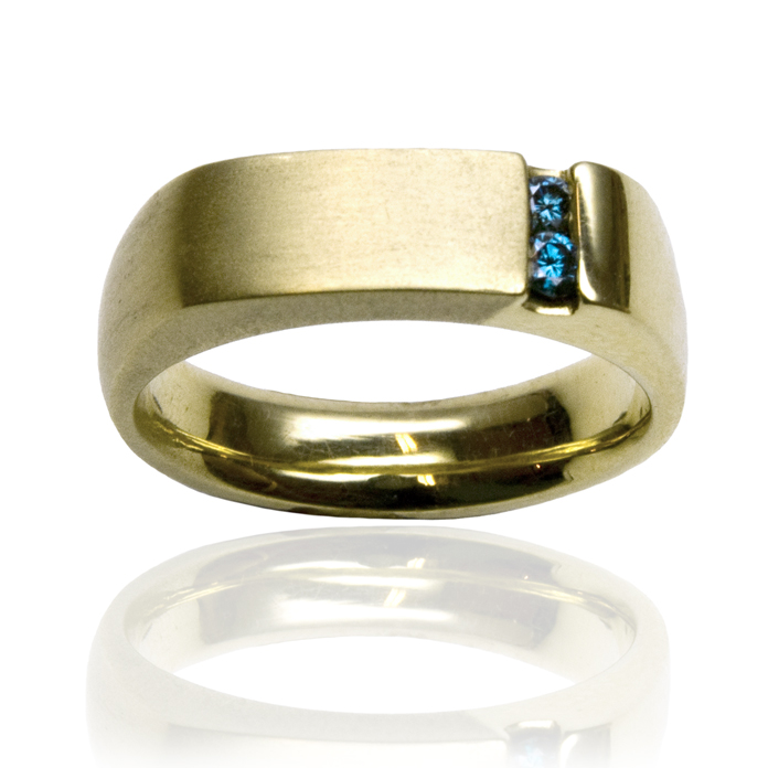 """""""Offset Channel"""" men's ring — Two melee round cut color-enhanced Blue Diamonds, .10cts, set in 18k yellow gold."""
