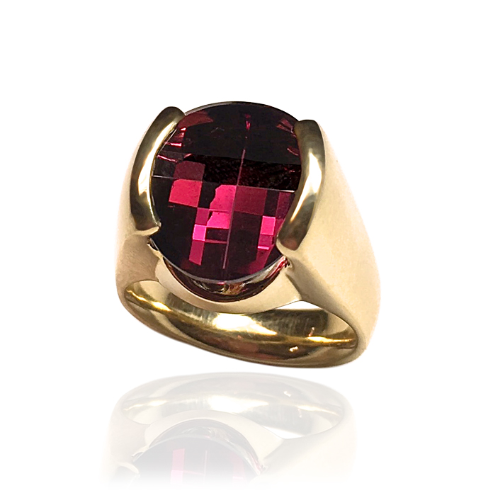 """The Rose"" - Straight channel 18k yellow gold ladies ring with a spectacular ""OVOB"" patented cut 12.17-carat Rhodalite Garnet by award-winning cutter Stephan Avery. This color Garnet is extremely rare."