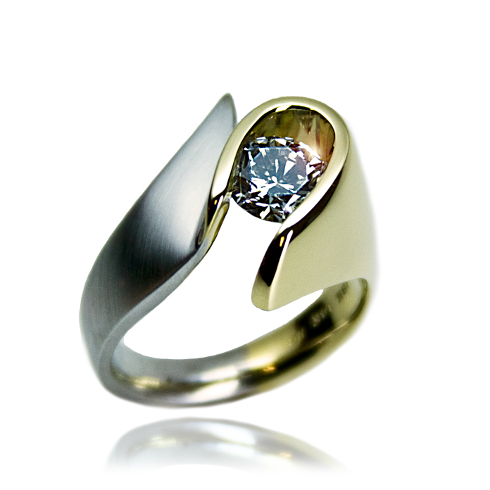 """Diamond E-Loop"" ladies ring — Round Brilliant Cut Diamond, 1.05cts, set in 18k yellow gold and 14k white gold."