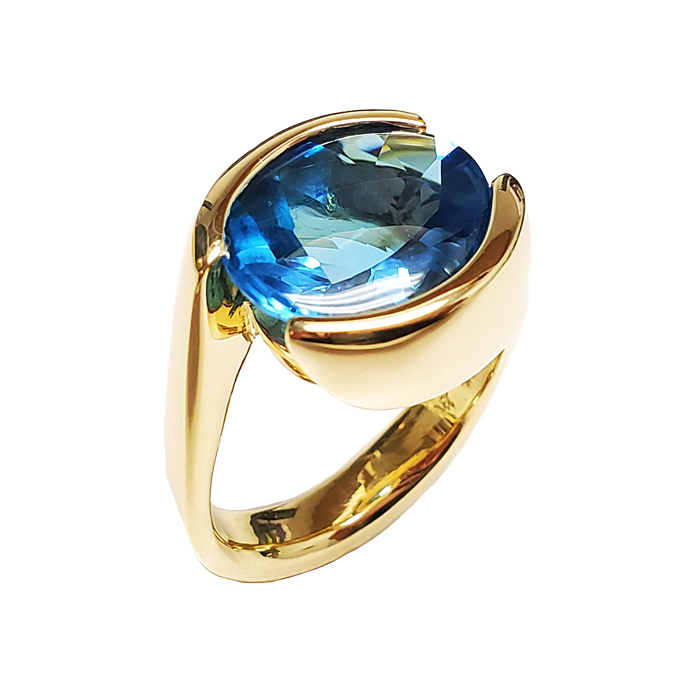 "Item #KRY-BT-1171 ""Elegant Channel"" Blue Topaz Ladies Ring, Oval Blue Topaz =7.71cts, 18KWG"